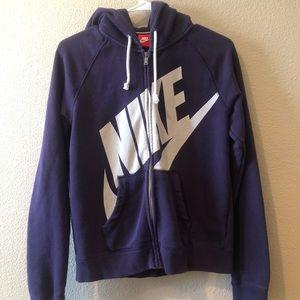 Woman's zip up purple Nike sweatshirt